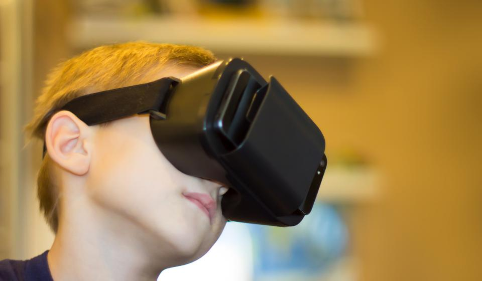 Boy looking into virtual reality viewer