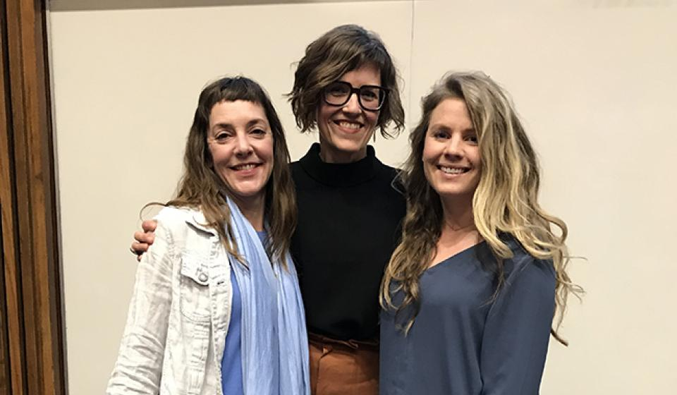 Three health coaches gather after presenting their Capstone Projects at the University of Minnesota Center for Spirituality & Healing
