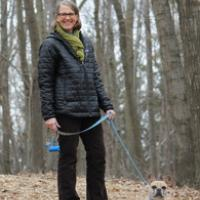 Jean Larson walking her dog in the woods during in autumn